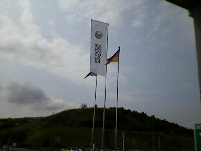Photo of 12m Flagpole with rotary arm and two 9m standard flagpoles